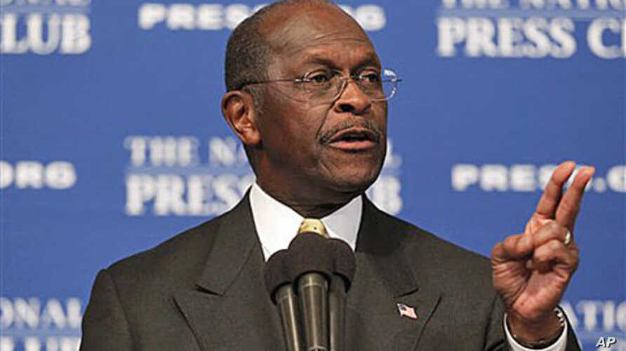 Republican presidential candidate Herman Cain answers questions at the National Press Club in Washington, October 31, 2011.