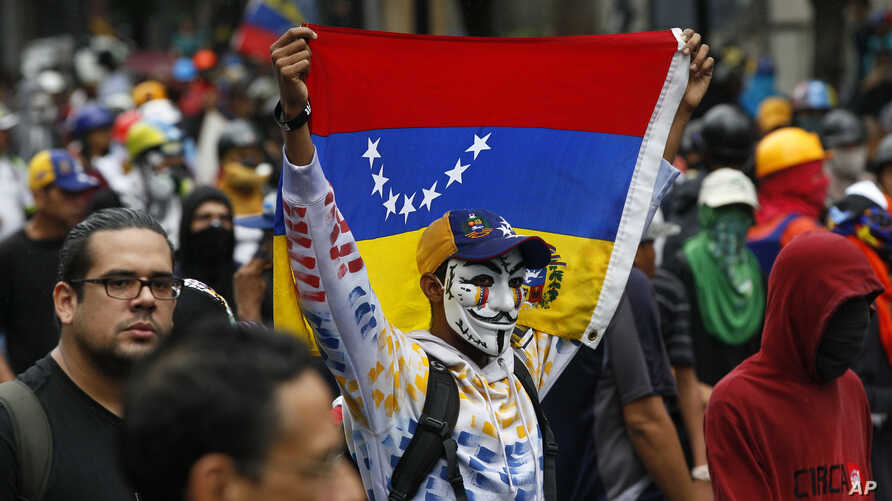 Demonstrators march against the government during protests in Caracas, Venezuela, Thursday, June 29, 2017. Demonstrators are taking the the streets after three months of continued protests  against the government of President Nicolas Maduro.