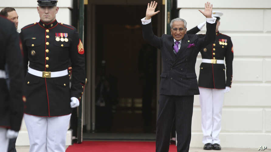 Pakistan's Foreign Minister Tariq Fatemi waves upon arrival at the White House in Washington, during the nuclear security summit, March 31, 2016..