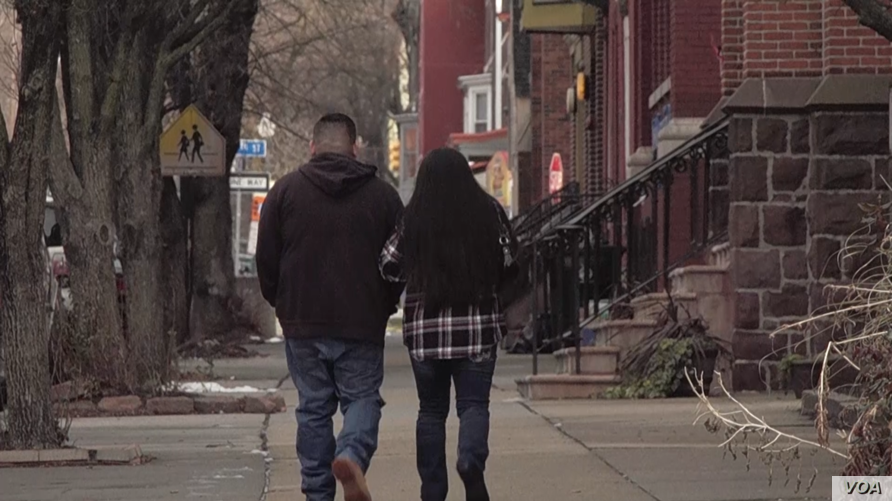 Undocumented immigrant Raul, who has been in the United State for 10 years, and his wife walk down a street in Harrisburg, Pennsylvania.