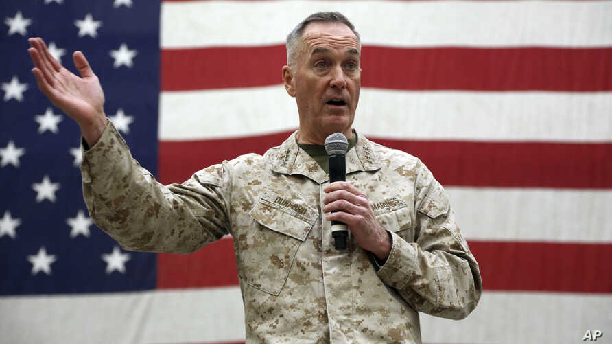 FILE - Gen. Joseph Dunford, chairman of the Joint Chiefs of Staff speaks during a ceremony on Christmas Eve at a U.S. airfield in Bagram, north of Kabul, Afghanistan, Dec. 24, 2017.