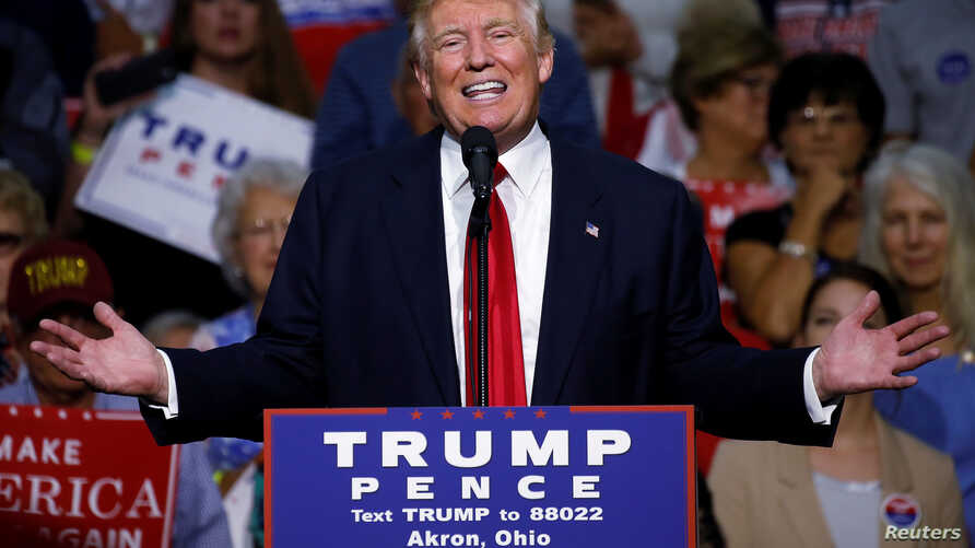 Republican presidential nominee Donald Trump speaks onstage during a campaign rally in Akron, Ohio, U.S., Aug. 22, 2016.