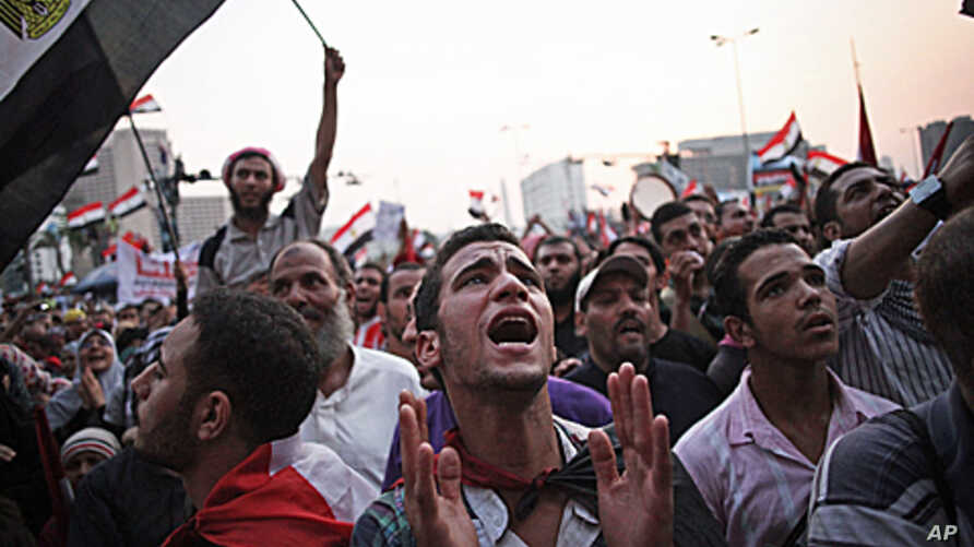 Egyptian protesters shout slogans in Cairo's Tahrir Square as the country awaits the outcome of the presidential runoff vote, June 23, 2012 (AP).