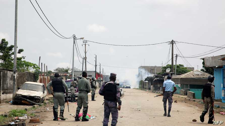 Gabonese gendarmes patrol in the Cocotiers neighborhood near the headquarters of the national broadcaster Radiodiffusion Television Gabonaise (RTG) in Libreville on Jan. 7, 2019 after a group of soldiers sought to take power in Gabon while the countr