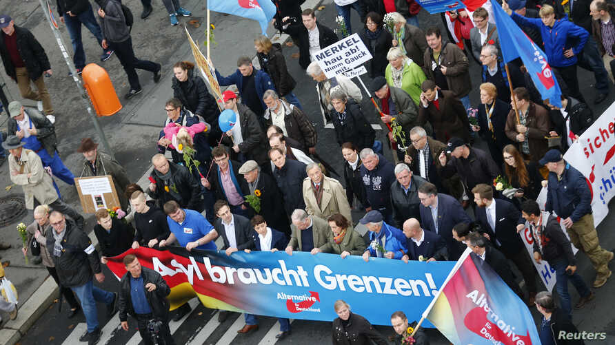 Supporters of the right-wing Alternative for Germany (AfD) demonstrate against the German government's new policy for migrants in Berlin, Germany, Nov. 7, 2015.