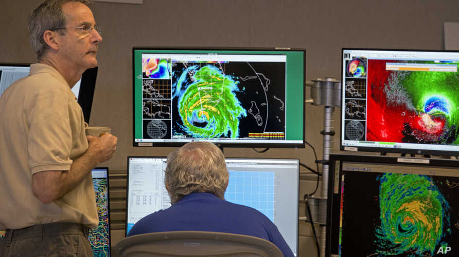 National Hurricane Center Acting Director Ed Rappaport, left, and Senior Hurricane Specialist Richard Pasch monitor Hurricane Irma at the National Hurricane Center in Miami, Sept. 10, 2017.
