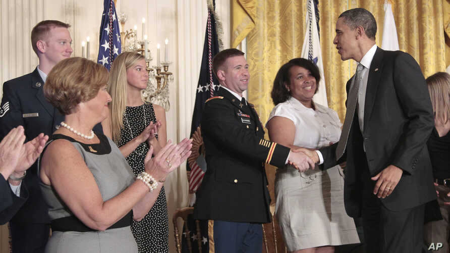 FILE - President Barack Obama greets members of the military and their families at the White House after the launch of Joining Forces, a national initiative to support service members and their families through job, wellness and educational opportuni