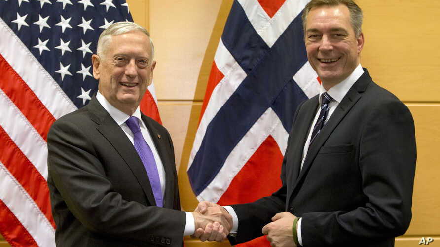 FILE - U.S. Secretary for Defense Jim Mattis, shakes hands with Norway's Defense Minister Frank Bakke-Jensen prior to a meeting on the sidelines of a NATO defense ministers meeting at NATO headquarters in Brussels on Wednesday, Nov. 8, 2017