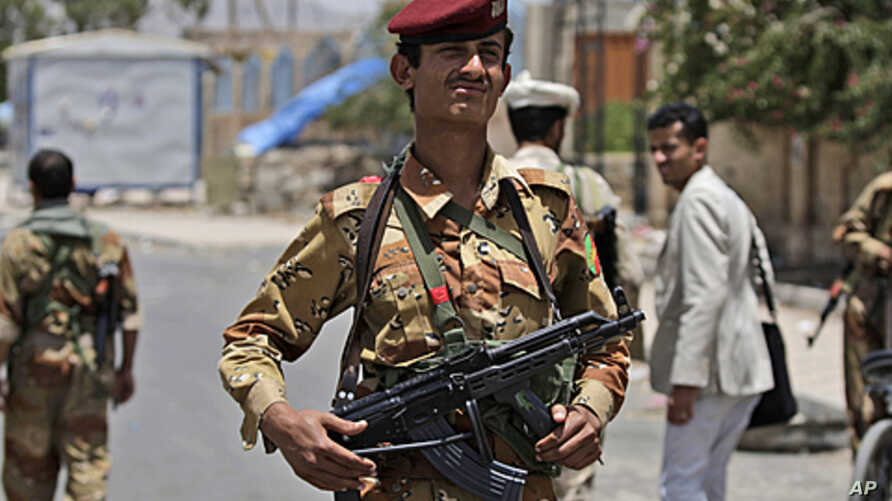 A Yemeni army officer stands at a checkpoint in Sana'a, Yemen, June 9, 2011