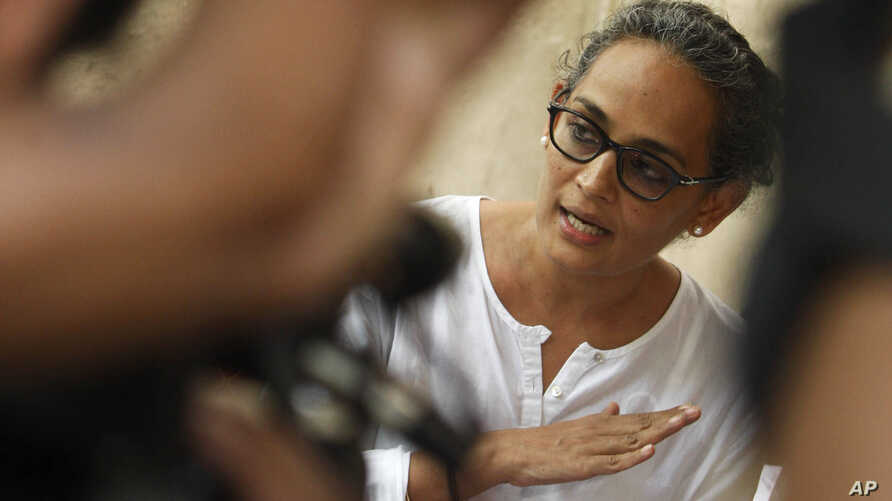 FILE -  Booker Prize-winning novelist Arundhati Roy speaks during a meeting protesting the killing of freelance journalist Hem Chand Pandey in a police encounter, in New Delhi, India.