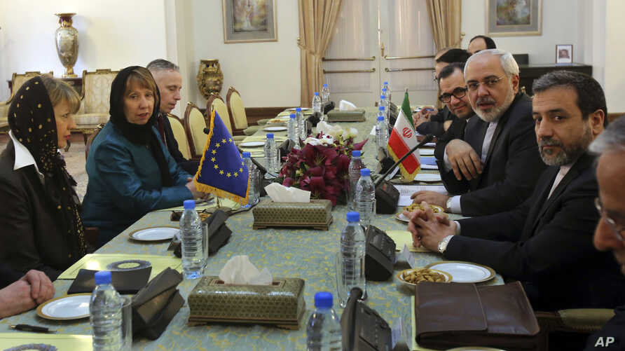 The European Union's foreign policy chief Catherine Ashton (2nd L) and her delegation attend a meeting with Iranian Foreign Minister Mohammad Javad Zarif (2nd R) and his colleagues in Tehran, Iran, March 9, 2014.