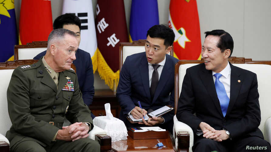 U.S. Chairman of the Joint Chiefs of Staff Gen. Joseph Dunford talks with South Korean Defence Minister Song Young-moo during their meeting at the Defence Ministry in Seoul, South Korea, Aug. 14, 2017.