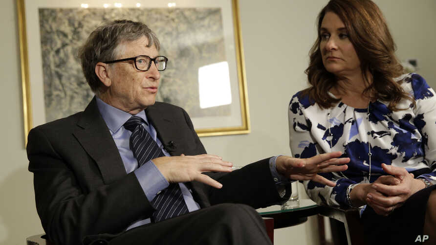 FILE - Bill and Melinda Gates talk to reporters about the 2016 annual letter from their foundation, the Bill and Melinda Gates Foundation, in New York, Feb. 22, 2016. Researchers are trying to infect mosquitoes in Brazil and Colombia with a type of b