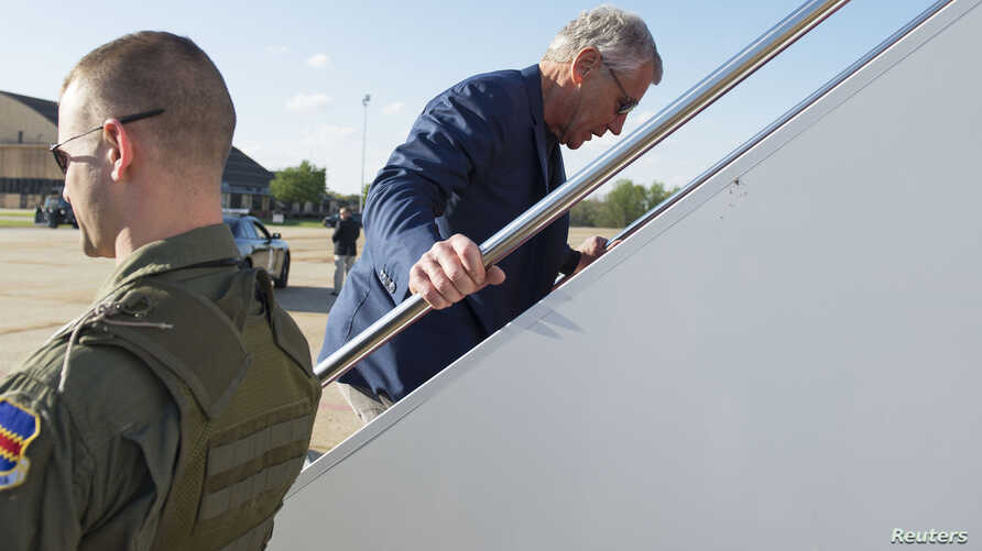 US Secretary of Defense Chuck Hagel boards an aircraft for a trip Middle East region at Andrews Air Force base near Washington, DC, April 20, 2013.