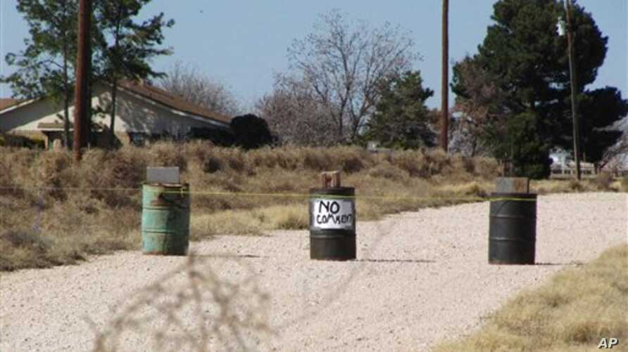 The driveway to the Shatto family home, rear left, is seen in Gardendale, Texas, March 1, 2013.