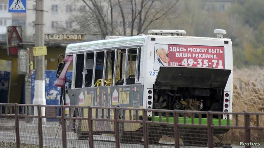A bus damaged by an explosion is seen on a street in Volgograd October 21, 2013.