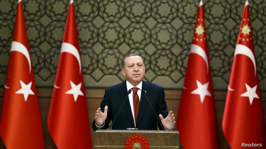 Turkish President Tayyip Erdogan makes a speech at the Presidential Palace in Ankara, Oct. 26, 2016.