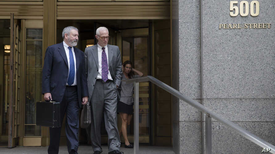 Jonathan Blackman, left, an attorney representing Argentina in their ongoing debt issues, leaves the Federal court in New York, Sept. 29, 2014.