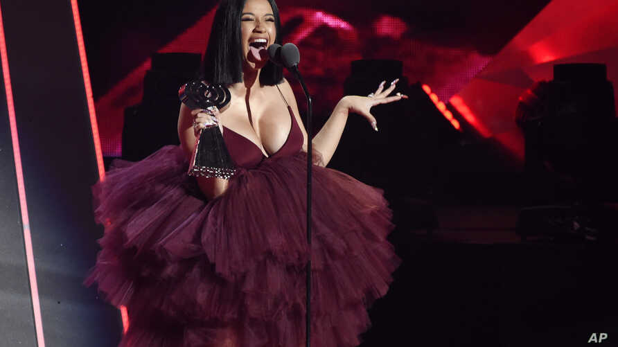 FILE - Singer Cardi B accepts the Best New Artist award during the 2018 iHeartRadio Music Awards at The Forum in Inglewood, California, March 11, 2018.