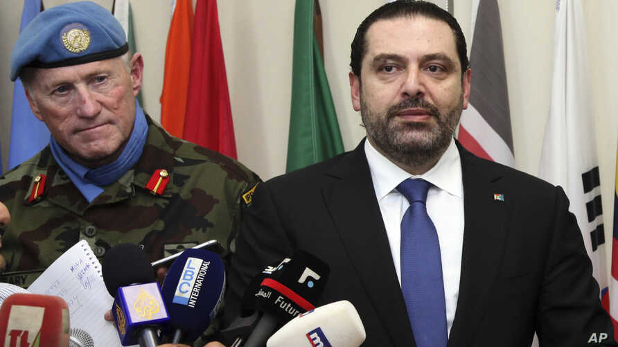 Lebanese Prime Minister Saad Hariri, right, speaks to journalists, as he stands next of Head of Mission and Force Commander of UNIFIL, Maj. Gen. Michael Beary, left, at U.N. peacekeepers headquarters, at the coastal border town of Naqoura, south Leba