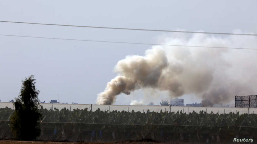 Smoke rises near the area where the Israeli forces said a significant cross-border tunnel from the Gaza Strip was destroyed, near Israel's border with the Gaza Strip, Dec. 10, 2017.