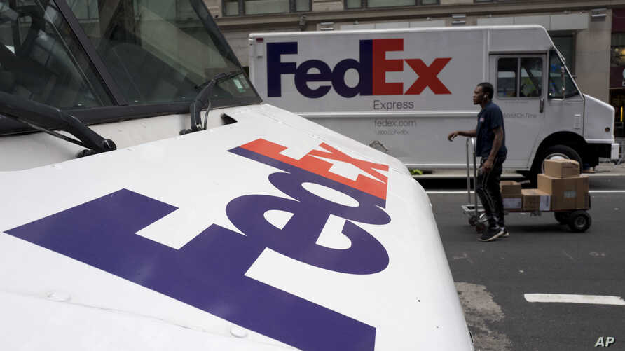 FILE - FedEx trucks are seen parked in New York, Aug. 22, 2017. Companies with ties to the National Rifle Association have been dealing with increasing public pressure since the Parkland, Florida, shooting that killed 17 people earlier this month to