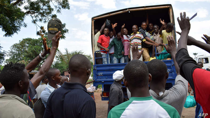Former inmates wave from a lorry after having been released from the Mpimba central prison in Bujumbura, Jan. 23, 2017.