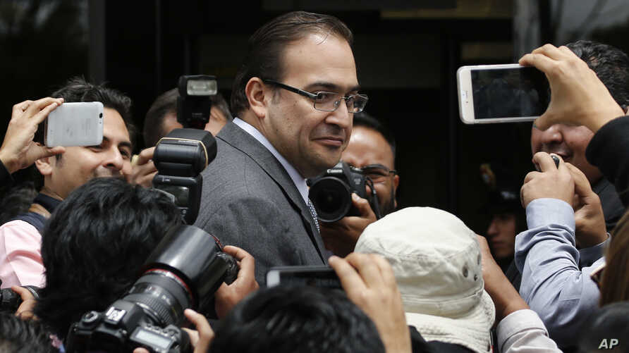 FILE - Veracruz Gov. Javier Duarte arrives to the Attorney General's Office in Mexico City on Aug. 5, 2016. The embattled outgoing governor of an eastern Mexico state faces federal corruption investigations said Oct. 12, 2016, that he will leave ear