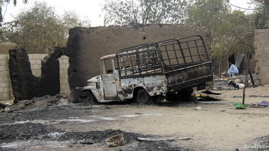 A vehicle used by Islamist militants is pictured damaged after what Nigerian authorities said was heavy fighting between security forces and the militants in Baga, a fishing town on the shores of Lake Chad, adjacent to the Chadian border, April 21, 2...