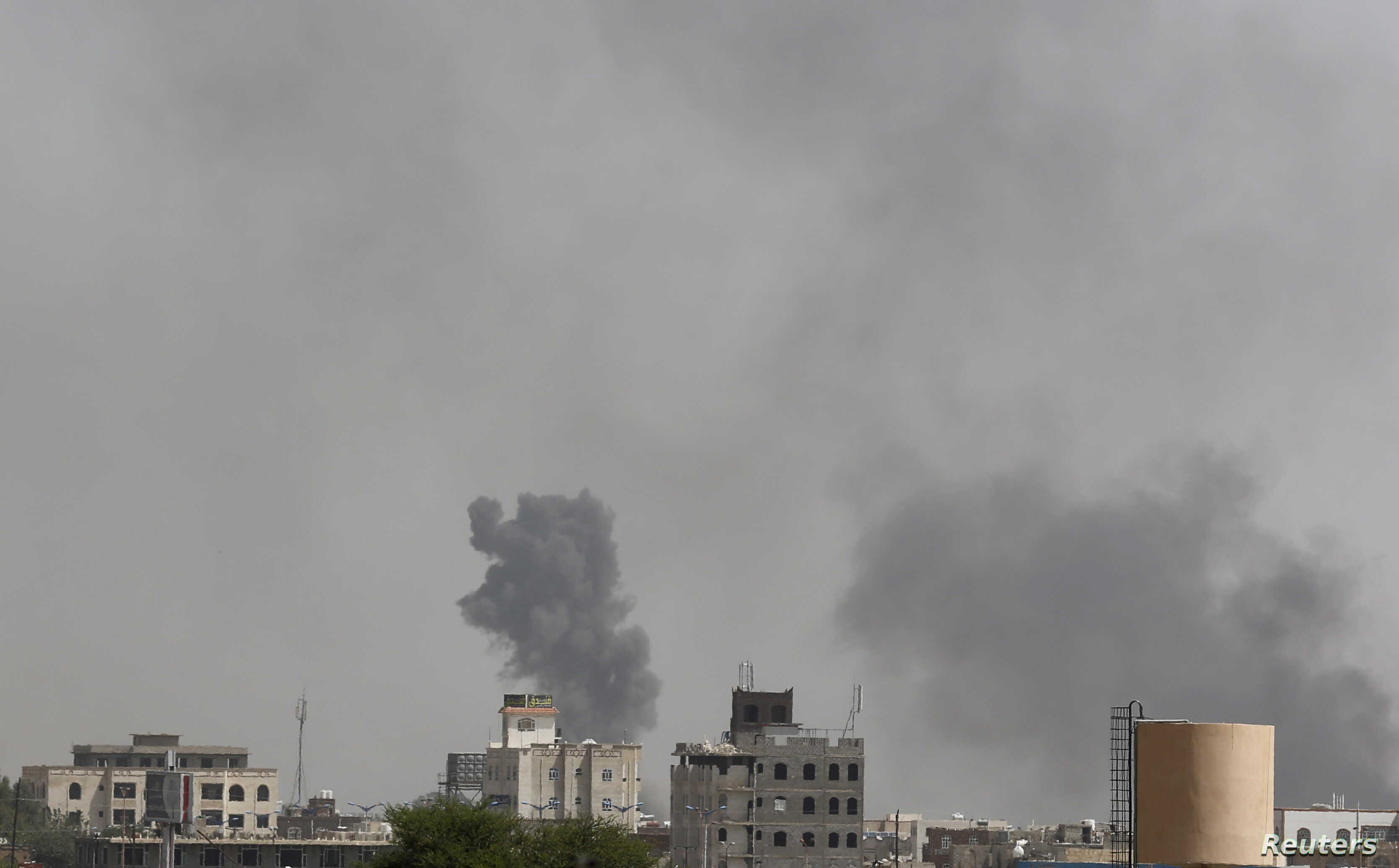 Smoke billows from the site of Saudi-led air strikes on al-Dailami air base in Yemen's capital Sana'a, Sept. 6, 2015.