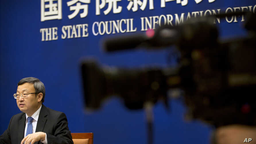 Chinese Vice Minister of Commerce Wang Shouwen speaks during a press conference about a newly-released cabinet report on China's trade record at the State Council Information Office in Beijing, June 28, 2018.