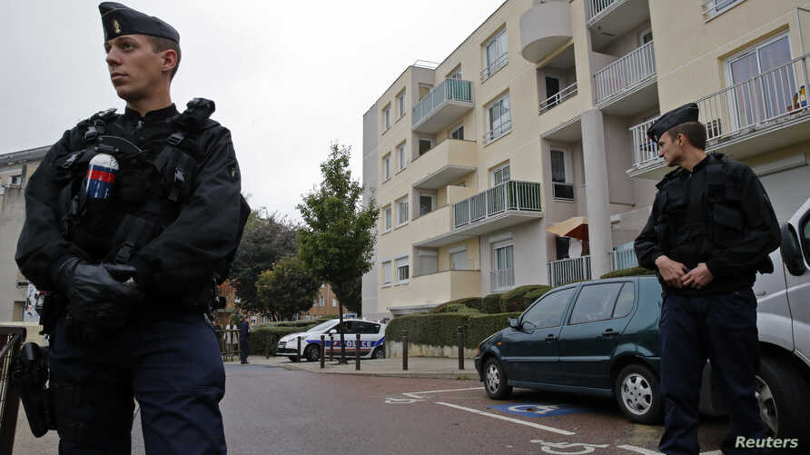French gendarmes secure a garage entrance, where an anti-terrorist raid was conducted four days ago, in Torcy near Paris October 10, 2012.