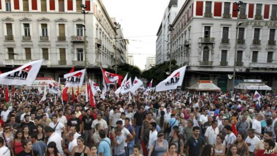 Workers take part in a rally during a protest by the PAME Communist-affiliated union in central Athens, July 20, 2011