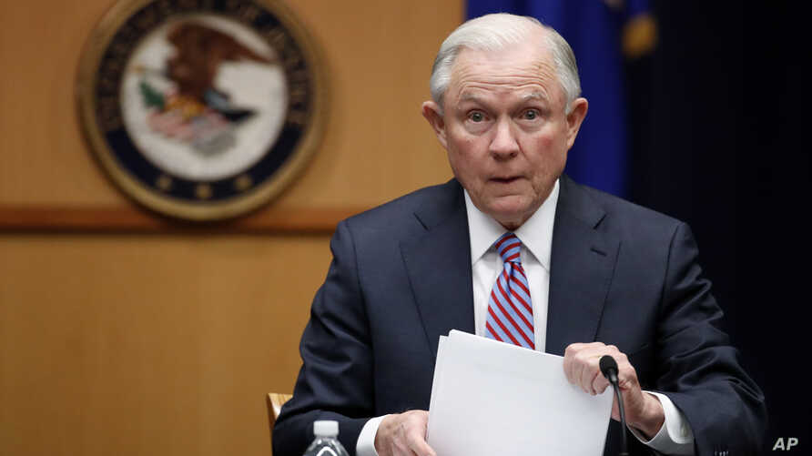 FILE - U.S. Attorney General Jeff Sessions prepares to speak before a meeting at the Department of Justice in Washington, April 18, 2017.