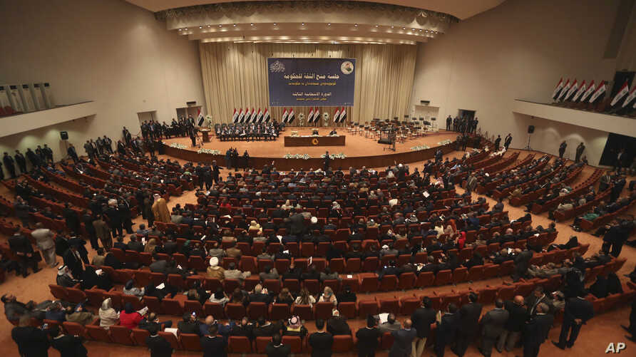 FILE - In this Sept. 8, 2014 file photo, Iraqi lawmakers attend a session in Baghdad, Iraq.