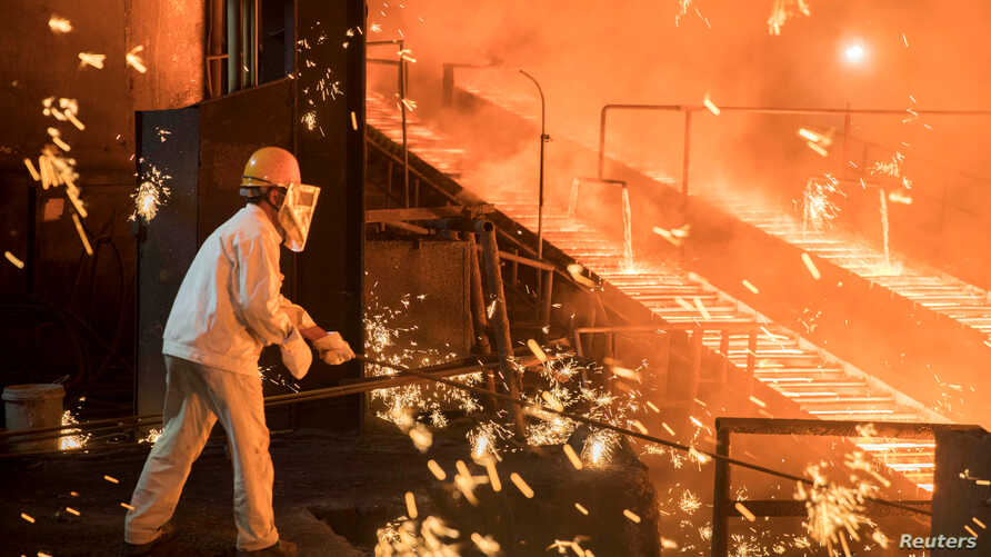 FILE - A laborer works at a steel plant of Shandong Iron & Steel Group in Jinan, Shandong province, China, July 7, 2017.