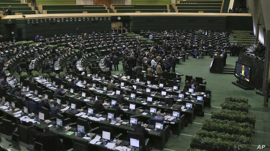 FILE - This photo taken on Feb. 19, 2017 shows an open session of the Iranian parliament in Tehran. Iran's parliament voted overwhelmingly Sunday to increase spending on its ballistic missile program and the foreign operations of Revolutionary Guard.