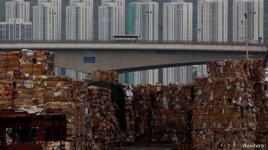Tonnes of waste paper to be shipped to mainland China are piled up at a dock in Hong Kong, China, Sept. 15, 2017.