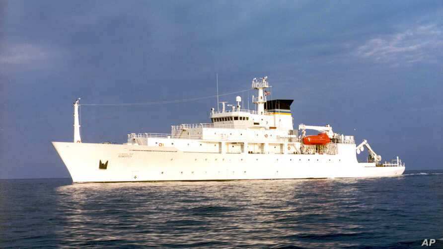 In this undated photo released by the U.S. Navy Visual News Service, the USNS Bowditch, an civilian oceanographic survey ship, sails in open water. The Bowditch was recovering two drones Thursday when a Chinese navy ship approached and sent out a sma