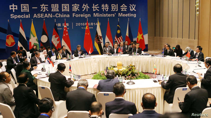 China's Foreign Minister Wang Yi (C) speaks during the Special ASEAN-China Foreign Ministers' Meeting in Yuxi, Yunnan Province, China, June 14, 2016