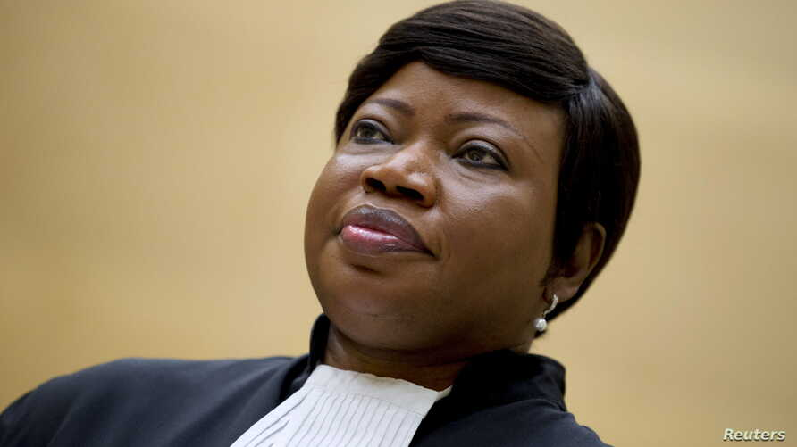 Prosecutor Fatou Bensouda waits for former Congo vice-president Jean-Pierre Bemba to enter the courtroom of the International Criminal Court to stand trial, in The Hague, Sept. 29, 2015.