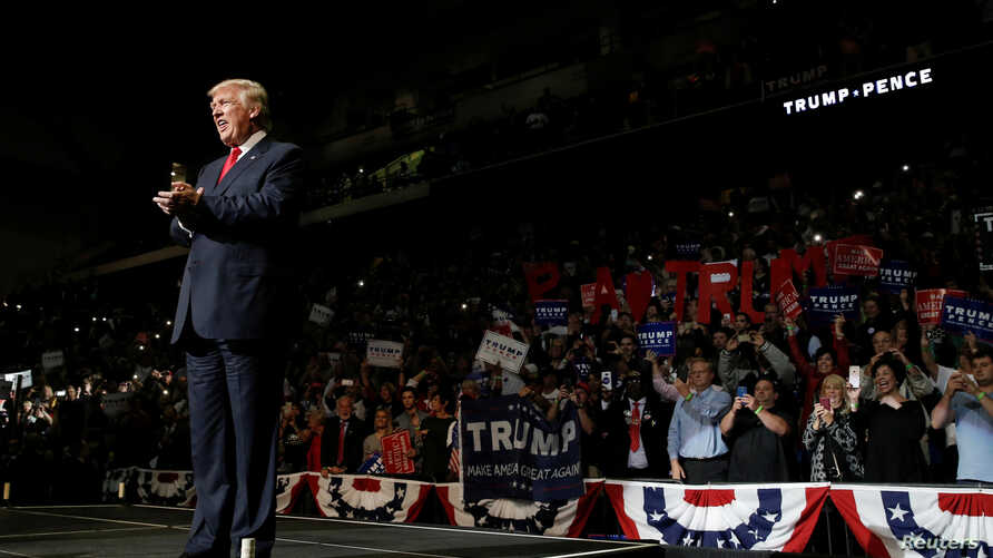 Republican U.S. presidential nominee Donald Trump arrives on stage at a campaign rally in Wilkes-Barre, Pa., Oct. 10, 2016.