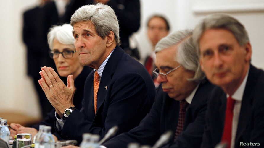 U.S. Secretary of State John Kerry  meets with foreign ministers of Germany, France, China, Britain, Russia and the European Union during the Iran talks meetings at a hotel in Vienna, Austria, July 7, 2015.