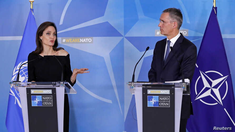 UNHCR Special Envoy actor Angelina Jolie and NATO Secretary General Jens Stoltenberg hold a news conference at the Alliance's headquarters in Brussels, Belgium, Jan. 31, 2018.