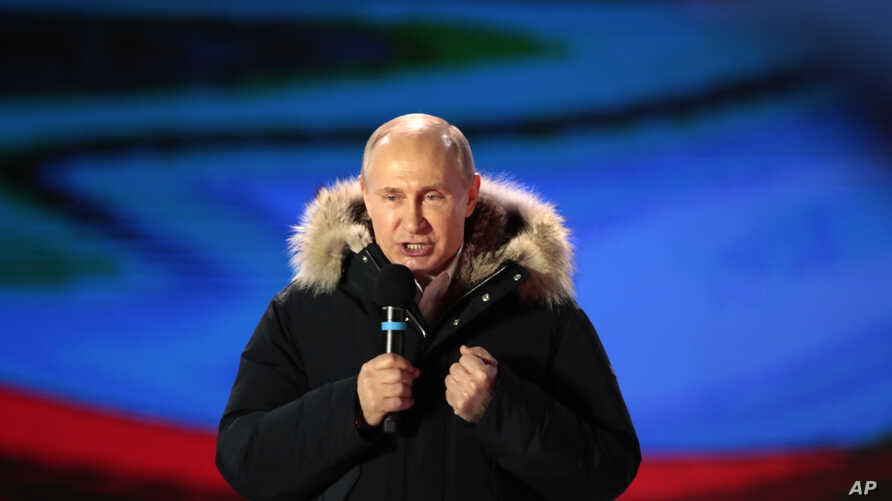 Russian President Vladimir Putin speaks during a rally near the Kremlin in Moscow, Sunday, March 18, 2018.