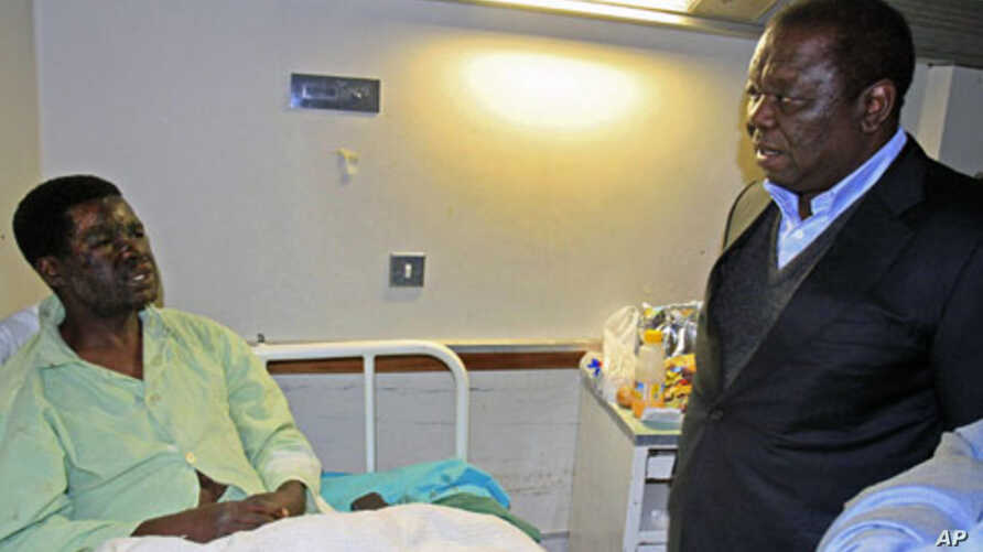 Zimbabwe's Prime Minister Morgan Tsvangirai visits Movement for Democratic Change [MDC] youth leader Yaya Kassim - who was attacked while visiting MDC supporters, allegedly by youths loyal to President Robert Mugabe's ZANU PF party - at a hospital in