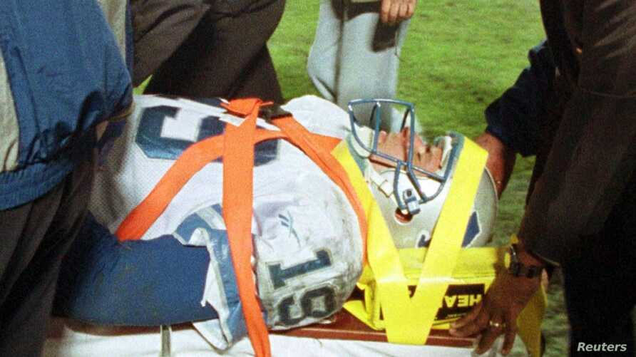 FILE - Detroit Lions quarterback Scott Mitchell is taken to a hospital after he was injured during action against the Tampa Bay Buccaneers.