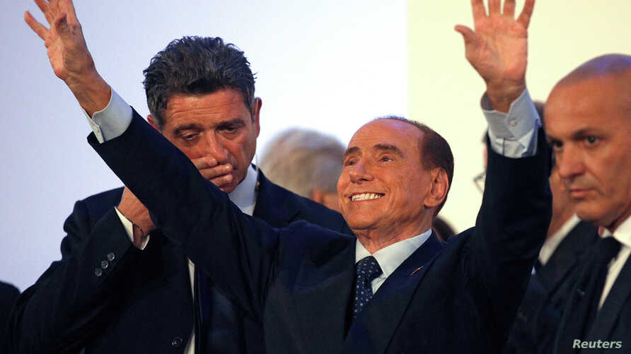 Forza Italia party leader Silvio Berlusconi waves as he leaves at the end of a rally in Catania, Italy, Nov. 2, 2017.