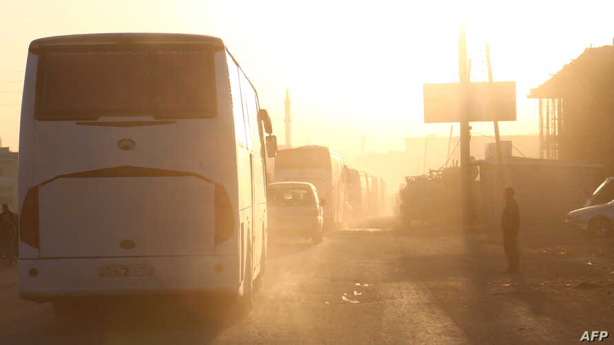 Buses carrying Jaish al-Islam fighters and their families, from the former rebel bastion's main town of Douma, arrive in the Syrian town of Azaz, April 5, 2018, on their way to a refugee camp.