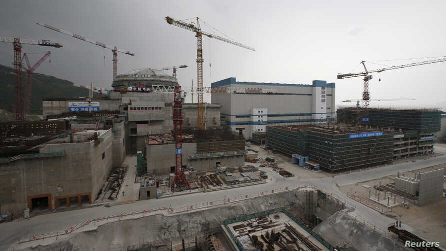 FILE - A nuclear reactor and related factilities as part of the Taishan Nuclear Power Plant, to be operated by China Guangdong Nuclear Power (CGN), is seen under construction in Taishan, Guangdong province, October 17, 2013.